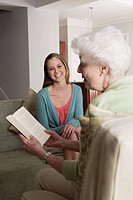 Granddaughter and grandmother reading