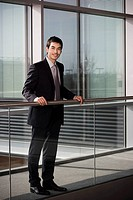Young businessman in smart, modern office
