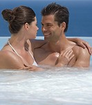 A couple relaxing in a jacuzzi