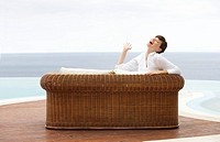 A woman relaxing on a sofa (thumbnail)
