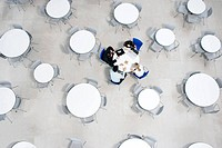 Overhead view of informal business meeting at table of staff canteen (thumbnail)