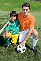 Boy posing with soccer coach
