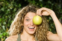 A woman holding an apple
