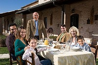 Family at table outdoors