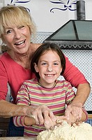 Girl and grandmother baking