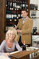 Man and woman in wine shop