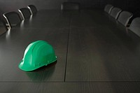 Hard hat on a conference table