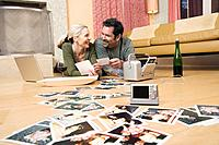 Couple looking at photographs