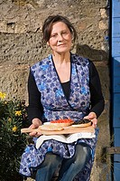 Mature woman holding slices of bruschetta