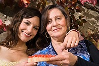 Mother and daughter holding a slice of bruschetta