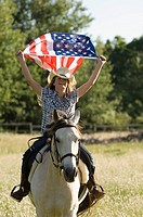 A girl holding the american flag (thumbnail)