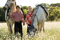 A boy and girl with horses (thumbnail)