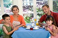 Family posing at breakfast table