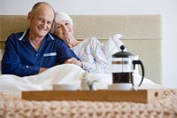 Senior couple having breakfast in bed (thumbnail)