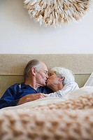 A senior couple having a kiss