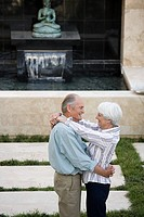 A senior couple hugging