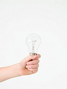 Child holding a lightbulb