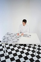 Man doing crosswords