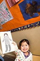 A girl showing a pencil drawing