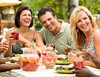 Multi_ethnic friends eating outdoors