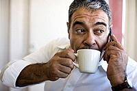 Hispanic man drinking coffee