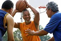 Multi-ethnic men playing basketball (thumbnail)