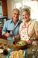 Senior Hispanic couple preparing food