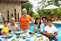 Multi_generational Hispanic family eating outdoors