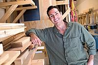 Hispanic man in wood shop (thumbnail)
