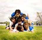 Multi_ethnic male soccer players in pile up