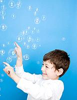 Hispanic boy popping bubbles