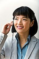 Asian businesswoman wearing headset