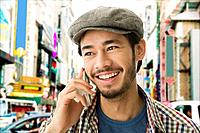 Asian man talking on cell phone