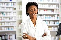 African female pharmacist with arms crossed