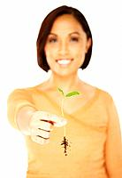 Asian woman holding seedling
