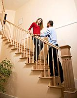 Multi_ethnic couple standing on stairs