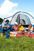 Multi_ethnic friends camping
