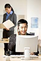 Asian businessman wearing headset