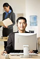 Asian businessman wearing headset