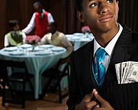 African teenager with money in suit jacket pocket