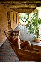 Hispanic man laying in hammock (thumbnail)
