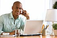 African man next to laptop