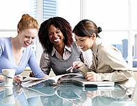 Multi_ethnic businesswomen laughing