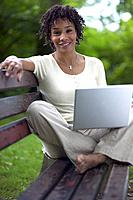 African woman with laptop outdoors