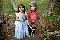 Hispanic siblings wearing Halloween costume