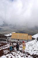 Ecuador - Cotopaxi Province. Cotopaxi National Park. Excursionists at Cotopaxi Volcano (5,890 m)