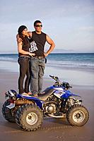 Couple on the beach with quad