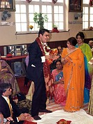 Mother and Son Clapping During the Hindu Engagement Ceremony at the Hindu Society Wimbledon London England