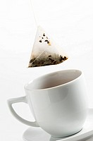 Close_up of a teabag dipping in a tea cup