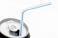 Close_up of a drink can with a drinking straw